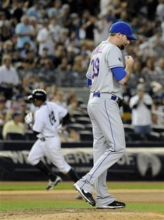 GAME 58: Saturday, June 9, 2012 - New York Mets relief pitcher Bobby Parnell (39) reacts on the mound as New York Yankees' Curtis Granderson (14) rounds third base after hitting a solo home run in the eighth inning of an interleague baseball game at Yankee Stadium in New York. The Yankees won 4-2. (AP Photo/Kathy Kmonicek)