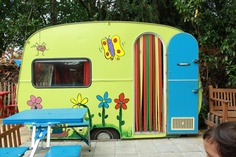 Do this with an old VW camper van shell for Lexie at the bottom of a big garden