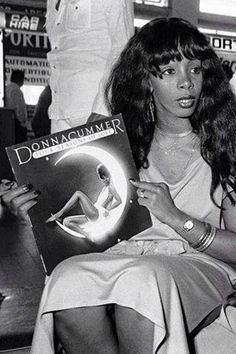Donna Summer with her album, 'Four Seasons of Love', 1976.