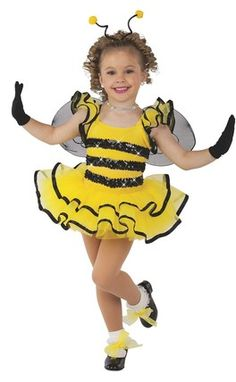 Yellow velour leotard with attached tricot sleeves and tiered skirt. Sequin and ribbon trim. Made in the USA. Wings, headband and shoe ties included XS | S | I | M | L | XL | CHILD