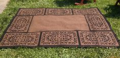 Perfect for inside your LARP tent! Persian style rug: created using a plain $12 6x8 rug, a wrought iron style rubber mat, and spray paint! Simply place the mat where you want the design and spray! So easy! This would also work great with a stencil.
