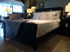 Solid maple queen size bed with hickory stain. You can chose different stains and hardware and even customize the headboard and footboard heights! Want to design your own bed? We can do that too!