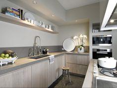 http://cdn1.welke.nl/photo/scale-614xauto-wit/greeploze-massief-houten-keuken-handgemaakt.1347536795-van-stuutkeukendesign.jpeg - klik om te vergroten