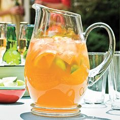 Slightly Sweet Tea (4 cups water  7 green tea bags    1/2 cup honey  4 cups cold water  1 navel orange, cut into wedges    1 lime, cut into wedges)