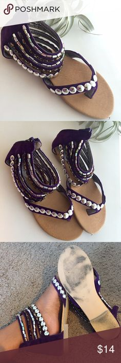Embellished sandals  Beaded sandals, with a purple pop of color. Excellent condition, barely worn. Zipper at the back for easy on/off access. Size marked 38, maybe closer to 37.5. Shoes Sandals