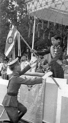 King Ananda Mahidol (aged 13), in whose favor King Prajadhipok abdicated in 1935, presents flag to youth organizations. After his summer vacation, he returns to school in Switzerland. (Photo: Life Magazine, 1939) | via: 2Bangkok.com)