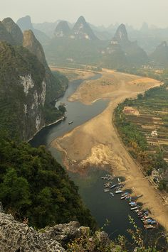Li River and Mountains, Yangshuo, Guilin, via Flickr.