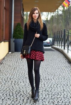 Plaid skirt, black overshirt, black tights and boots