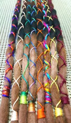 Check out this item in my Etsy shop https://www.etsy.com/listing/292673605/wool-dreadlocks-custom-wool-dreads