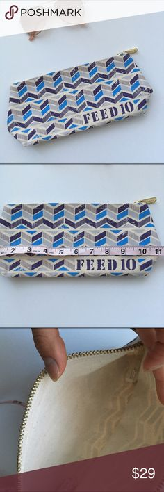 New feed makeup case Brand new. Never used. Completely clean and straight out of plastic package Feed Bags Cosmetic Bags & Cases