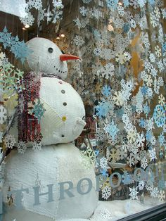 Anthropologie display. I love how it's so full of snowflakes that it looks like a blizzard.