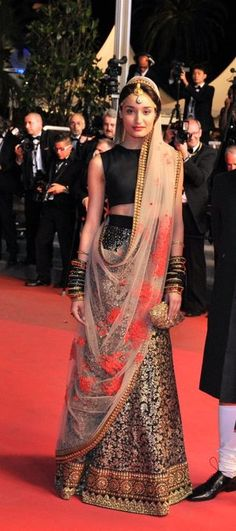 Black Sabyasatchi lehenga with beaded skirt and nude dupatta.