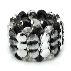 This beautiful bracelet has rows of textured circles on a comfortable stretch band. The silver and black button bracelet measure 1 3/4 inches wide on a one size fits most stretch band.