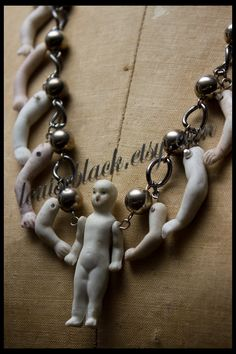 Naughty Antique Doll Parts Necklace by Louise Black. $69.50, via Etsy.