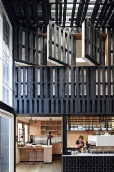 Pallets used to define interior space in the Industry Beans café, Australia. | Recyclart
