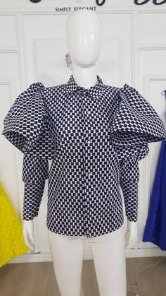 Aramide shirt African print wax (Does not stretch) Long sleeve Button closure Collared shirt Full flare details on the sleeve SIZES ABOVE US 22 WILL ATTRACT EXTRA COST Size chart UK 4, US 1 Bust : 30 Waist : 22.5 Hip: 32.5 UK 6, US 2 Bust : 33 Waist : 25.5 Hip: 35 UK 8, US 4 Bust : 34 Waist : 26.5 Hip: 36 UK 10, US 6 Bust : 36 Waist : 28.5 Hip: 38 UK 12, US 8 Bust : 38 Waist : 30.5 Hip: 40 UK 14, US 10 Bust : 40 Waist : 32.5 Hip: 42 UK 16, US 12 Bust : 42 Waist : 34.5 Hip: 44 UK 18, US 14… Ankara Dress, I Dress, African Print Fashion, Fashion Prints, Stylish Dresses, Elegant Dresses, Ankara Clothing, Ankara Styles, Collar Shirts
