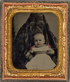 "ca. 1860's, [hand tinted ""hidden mother"" tintype portrait of a child]"