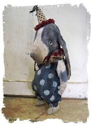 check out this website. She makes the most amazing vintage style mohair stuffed animals!  I just love them all!