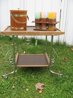 Mid Century Bar Cart  This cart wheels around with ease, the wood is fine the frame is sturdy/solid.  Has great multi tasking parts, can be a