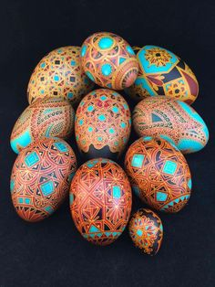 PysankyUSA Colorama Dye test artist Theresa Somerset: Batik style eggs, acid etched and dyed, on Goose, Turkey, Duck, Chicken and a wee quail. Tessellated and Moroccan inspired designs.