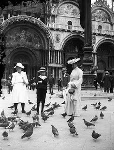 Well dressed woman and kids in St. Mark's Square complete with #fancyhats, #Venice