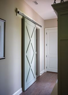 Barn door entry to Laundry Room #barndoor #customhome