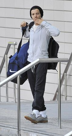 Up all night? Louis looked a little sleepy as he hauled his bag to the car, but gave a che...