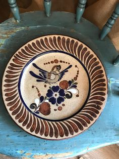 Vintage Mexican stoneware wall platter/plate, hand painted enamel bird and flower design, ready to hang by Lulubellebazaar on Etsy https://www.etsy.com/listing/545818974/vintage-mexican-stoneware-wall
