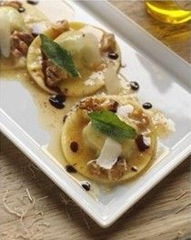 Arugula and goat cheese ravioli with walnut and sage butter sauce