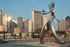 Dallas' Traveling Man sculpture with the Sheraton Dallas in the background.