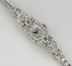 A diamond and platinum bracelet wristwatch, Hamilton  movement #730783A, 17j; a rectangular dial with raised indexes and blued steel hands; movement and dial signed; estimated total diamond weight: 3.00 carats; length: 7in.