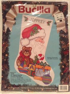 Image result for counted cross stitch santa toys stocking