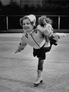 .Vintage photo of little girl ice skating with her doll, Saturday Evening Post Cover, March 2, 1940.