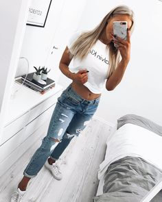 #fall #outfits white top with labelripped jeans
