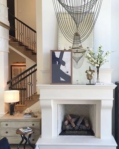 This fireplace!  | French Moderne Manor Project Designed by @alicelanehome, Built by @mcewancustomhomes, Photo by Weston Colton #alicelanehome