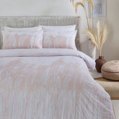Beautiful pampas stalks swaying in the wind give this cotton bedding a serene feeling, perfect for creating a relaxing bedroom space. Featuring delicately blush tones on a fresh white washed cotton, for an ultra soft touch, and finished with twin stitched edging for ultimate laid-back style. Made of 100% cotton for an impossibly comfortable sleep.
