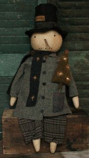 Hello everyone. My first offering for you tonight is a snow doll. He is 26 inches including his hat.  His head and limbs are made of aged wool, he's soft and fuzzy, you can't tell from the photos.  He has  a stitched face and a dried carrot nose. His coat pocket holds a vintage wool tree. I made slight indentations on the tree and they hold tiny flax nests and an egg.
