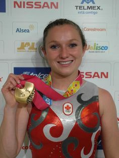 This is Rosie MacLennan from Canada with the Womens Individual Trampoline gold medal she won at the 2011 Pan Am Games. She went on to also win the Womens Individual Gold medal on Trampoline at the 2012 London Olympics. Nissan, Pan Am, Olympic Athletes, Olympics, Christmas Bulbs, Canada, London, Games, Gold