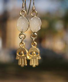 Rough Druzy Hamsa Dangle Earrings // 24k by MySerenityDesigns #hamsaearrings #hamsa #handmadejewelry #handmadeearrings #etsyshop #etsyjewelry #earrings #hamsahand #etsy #manopoderosa #jewelryonetsy #handofgod #handoffatima #handearrings #hamesh #gemstonejewelry #gemstoneearrings #etsylove #bohojewelry #bohoearrings #druzyearrings #druzy #druzyearringsforsale #handmade #sparkle #druzyjewelry #spring #shophandmade #myserenitydesigns #hamsajewelry