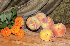 Arrangement with peach and orange roses