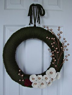 Green yarn wreath with ivory and redfelt by Wreathsbystephanie, $30.00