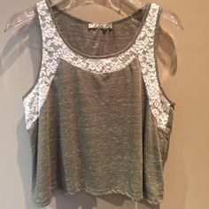Flirty top with lace Super cute top with lace detail, pretty heatherd  olive green color, cropped with a flare and open back. Only worn a handful of times and in great condition :) Tops Tank Tops
