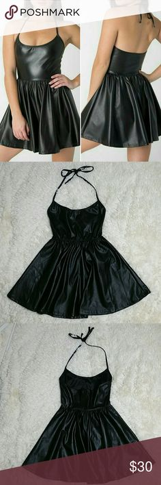 """American Apparel vegan leather figure skater dress American Apparel black vegan leather figure skater dress. Size S. Cute & chic hard to find black vegan leather dress. Tie at neck. Pleated full skirt. Small home on front left side (pic 7). No other flaws. 14"""" underarm to underarm 11"""" waist flat across but stretches about 2 inches 15"""" from waist American Apparel Dresses"""