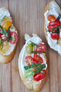Crostini with Whipped Feta and Tomatoes - originally a Barefoot Contessa recipe, like this blogger I have also made this and can agree that 1) it is delicious! 2) omit the salt, the feta is salty and the lemon brings out the flavors on its own, and pine nuts are totally optional