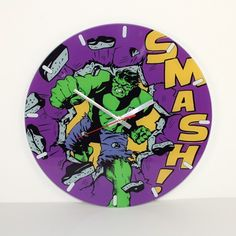 """Marvel Comics: Incredible Hulk Glass Clock- Face it True Believer, the Hulk doesn't usually deal in glass or keep a tight schedule. When he gets behind a glass clock, you know it's an incredible clock. Features a Silver Age rendition of the Hulk doing what he does best, the """"SMASH!"""" graphic says it all."""