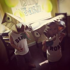DinoBash... Paper bags used to create dinosaur masks.