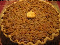 This delicious honey-kissed pumpkin pie is topped with a crunchy, nutty, crumb topping.