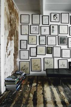 wooden floors. photographs on the wall. books!