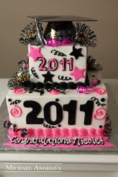 Number Cut-Outs #17Graduation  This two-tier square design is iced in buttercream with pink and black accents. The stars and the graduation year cut-outs are made from fondant. The plastic graduation cap and pom poms are also added for a little extra fun!