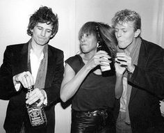 nightspell:  NYC, at the Ritz club after Tina Turner's concert, December 1982 via SONOFTHESILENTAGE.Keith Richards is giving side eye to Tina Turner for swiping his bottle of Jack from a side pocket! OMG, I was there...right up under the stage. Mick Jagger and Bianca were there as well as Bowie and Keith. They were watching up in the balcony. It was a night...